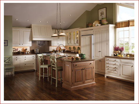 Kitchen with multi-color cabinets and wood floors